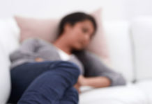 Young-woman-napping-on-the-couch