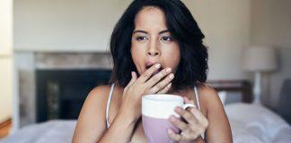 yawning girl holding mug