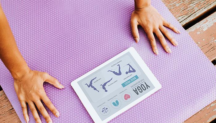 Women using app to do yoga