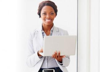 Woman holding laptop smiling