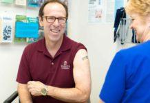 Trinity University Employee getting a flu shot