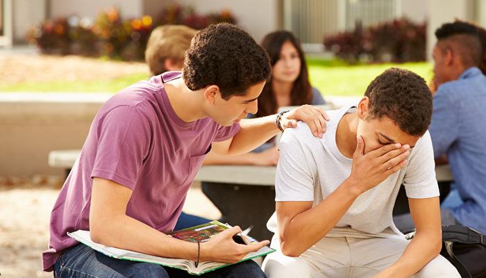 A boy consoling a friend