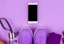 Workout gear and a cell phone on a purple background