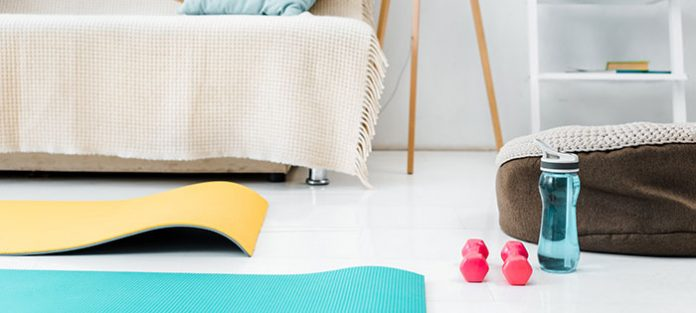 Yoga mat, weights, water bottle in living room