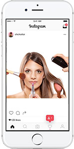 Cell phone with instagram- woman getting her makeup done