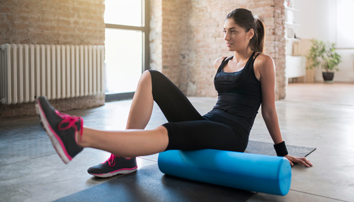 girl using foam roller
