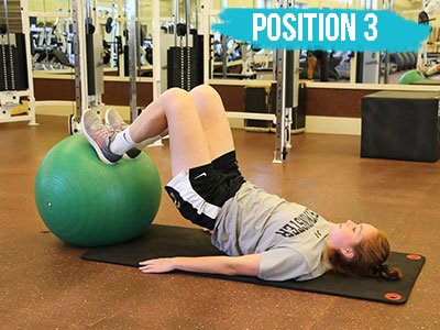 Hamstring curl on a physioball position 3