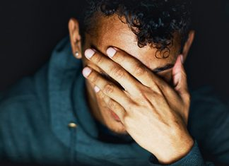 sad guy with hand over face