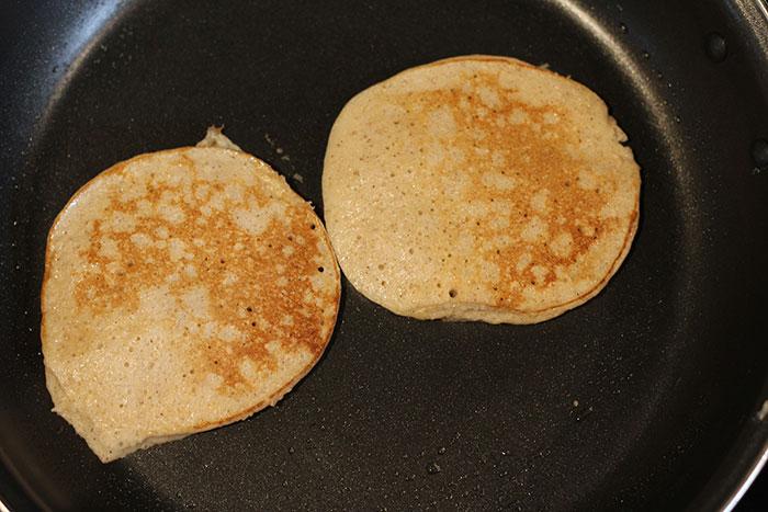 Cooked pancakes on frying pan