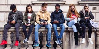 students looking down at phones
