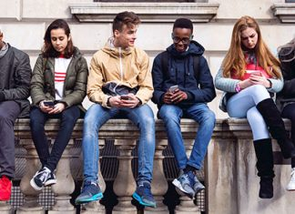 students looking down at phones