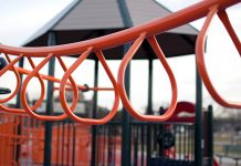 orange monkey bars on playground