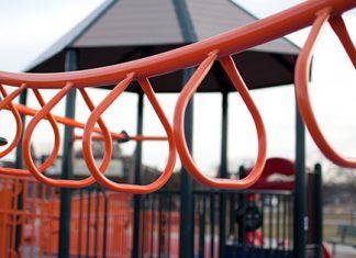 orange monkey bars on playground