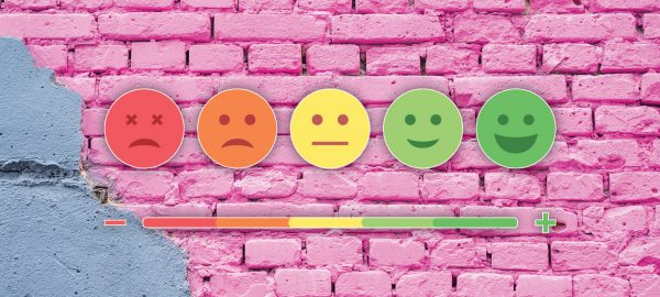 scale of sad to happy faces