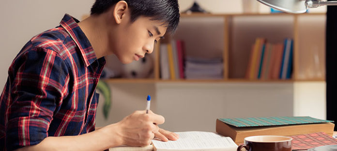 Boy studying at desk