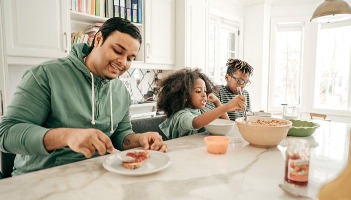 siblings having breakfast