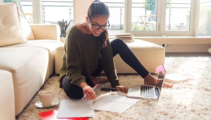 teen doing homework at home