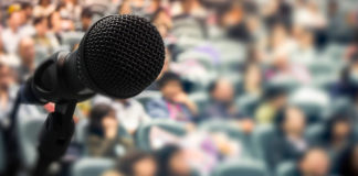Microphone in front of blurry crowd