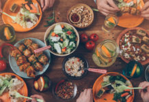 Top down view of dining table full of colorful foods