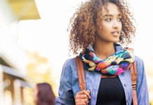 African American female walking on campus
