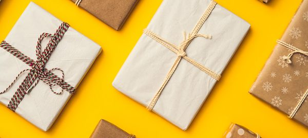 wrapped gifts on yellow background