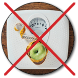 """Scale, apple, and tape measure with giant """"X"""" through image"""