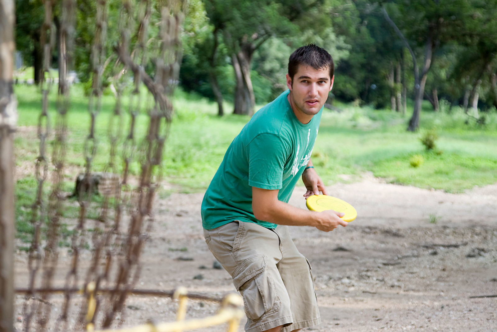 Young man playing frisbee golf