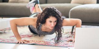 Woman doing pushups at home
