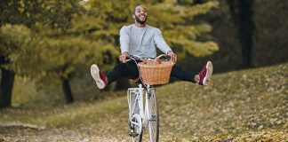 happy male cruising on bike