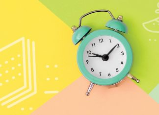 clock on colorful background | time management for college students