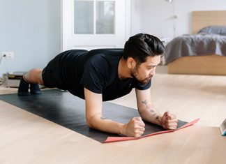 guy holding in plank | indoor workouts