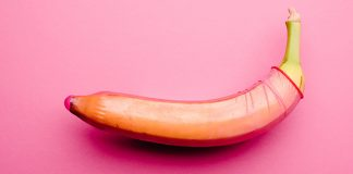 pink condom on banana | how effective are condoms against stds