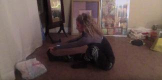 Eliza stretching bedroom floor