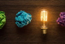 crumpled paper and light bulb