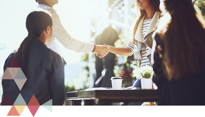 young professionals shaking hands