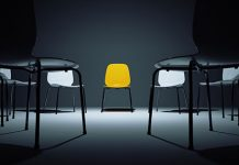 Black chairs surrounding yellow chair