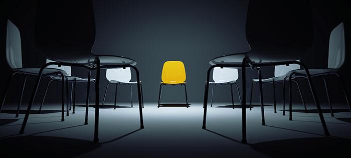 Black chairs surrounding yellow chair