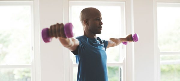 male doing arm workout at home