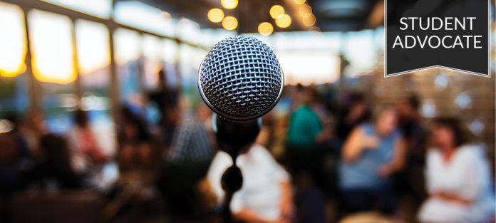 Student advocate: Microphone in front of a crowd