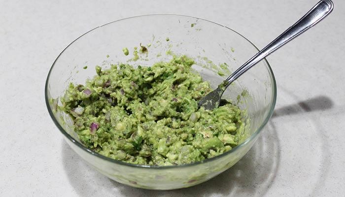 mashed avocado with onion and spices