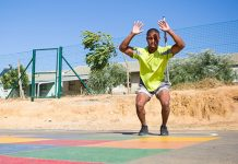 male performing burpees in outdoor playground