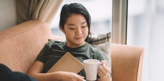 female relaxing on sofa   introvert benefits