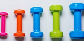 variety of colorful dumbbells | how to start weight lifting