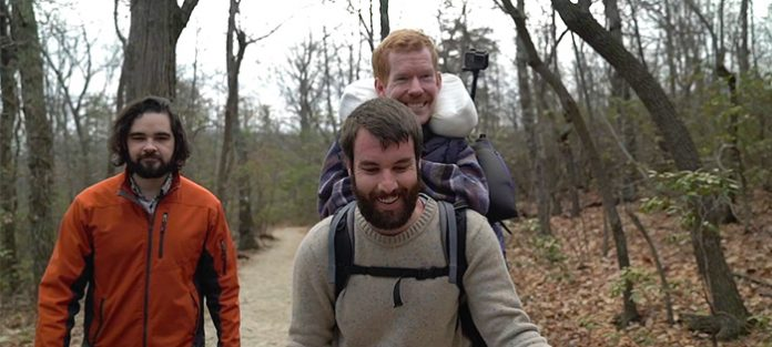 physically disabled Kevan being carried on back of a friend during a hike | guide to independent living for people with disabilities