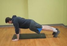 man doing pushups indoors
