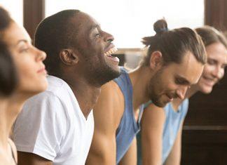 Happy guys doing yoga