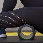 closeup of woman foam rolling leg | active rest day workout
