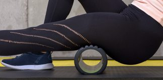 closeup of woman foam rolling leg | active rest day workout