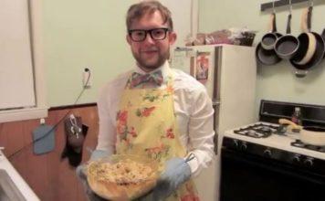 Jordan Johnston holding bowl of macaroni and cheese