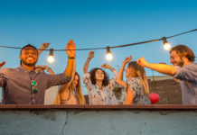 Group of friends enjoying rooftop party